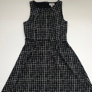 Black and white patterned dress. Flared at bottom